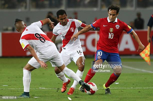 Carlos Lobaton of Peru struggles for the ball with Jorge Valdivia of Chile during a match between Peru and Chile as part of FIFA 2018 World Cup...