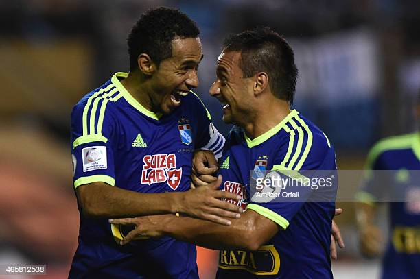 Carlos Lobaton of Sporting Cristal celebrates with Cesar Pereyra after scoring his team's second goal during a match between Racing Club and Sporting...