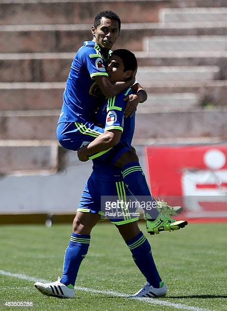Carlos Lobaton of Sporting Cristal celebrates with his teammate Irven Avila after scoring the second goal of his team against Real Garcilaso during a...