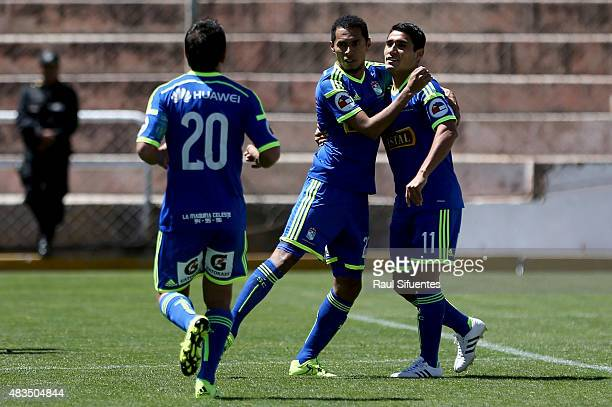 Carlos Lobaton of Sporting Cristal celebrates with his teammates after scoring the second goal of his team during a match between Real Garcilaso and...