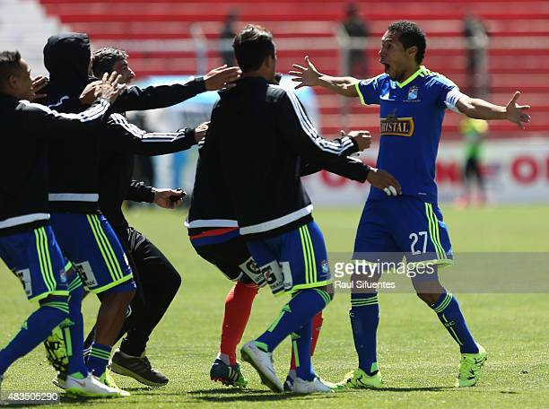 Carlos Lobaton of Sporting Cristal celebrates with his teammates after scoring the third goal of his team against Real Garcilaso during a match...