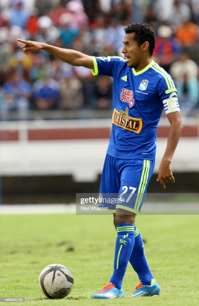 Carlos Lobaton of Sporting Cristal points during a match between Real Garcilaso and Sporting Cristal as part of the Copa Inca at Municipal de Urcos Stadium on Februay 15, 2014 in Cuzco, Peru.