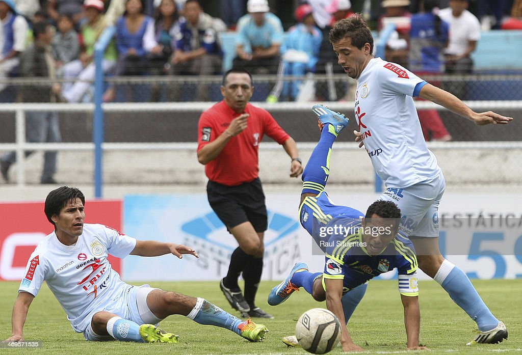 Carlos Lobaton (L) of Sporting Cristal struggles for the ball with Gonzalo Maulella (R) of Real Garcilaso during a match between Real Garcilaso and Sporting Cristal as part of the Copa Inca at Municipal de Urcos Stadium on Februay 15, 2014 in Cuzco, Peru.