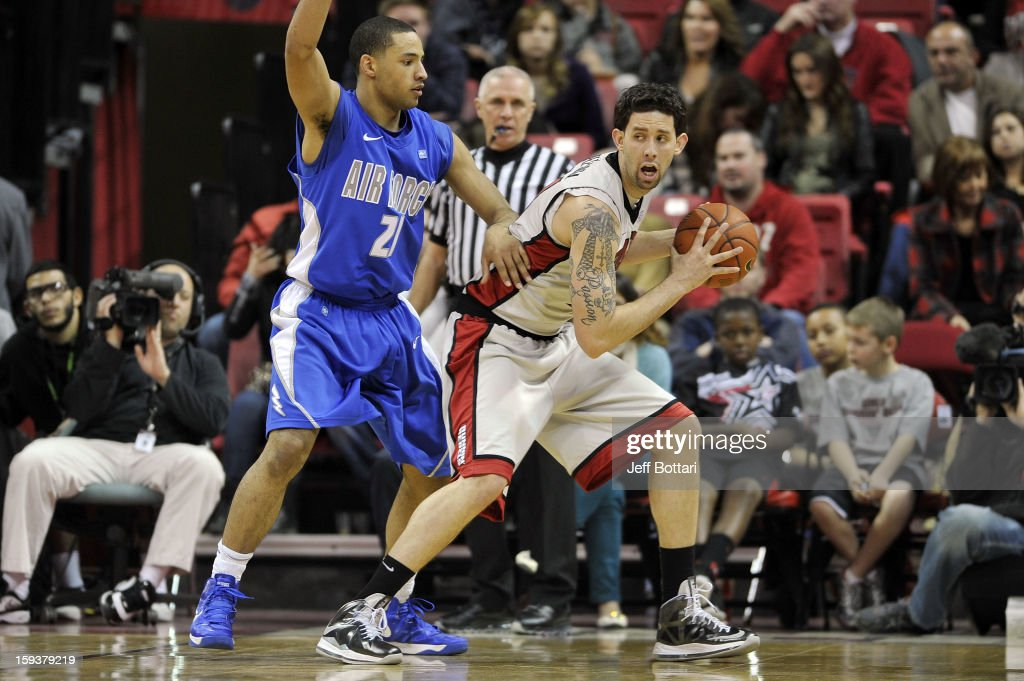 Carlos Lopez-Sosa #11 of the UNLV Rebels posts up in the key against DeLovell Earls #21 of the Air Force Falcons at the Thomas & Mack Center on January 12, 2013 in Las Vegas, Nevada. The Rebels won 76-71.