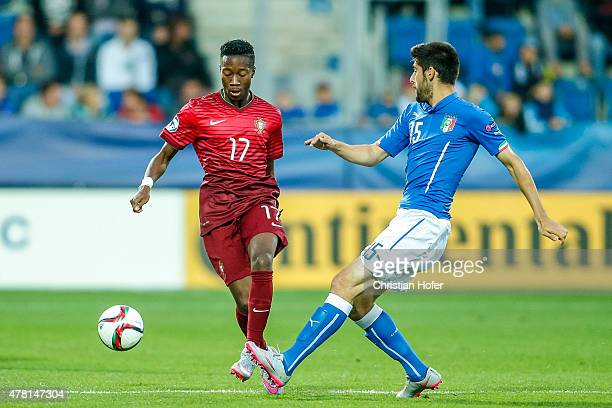 Carlos Mane of Portugal competes for the ball with Marco Benassi of Italy during the UEFA Under21 European Championship 2015 match between Italy and...