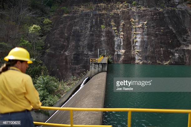 Carlos Manuel Quiros stands near a dam at a hydroelectric plant run by the Costa Rican Electricity Institute as the power company has managed to...
