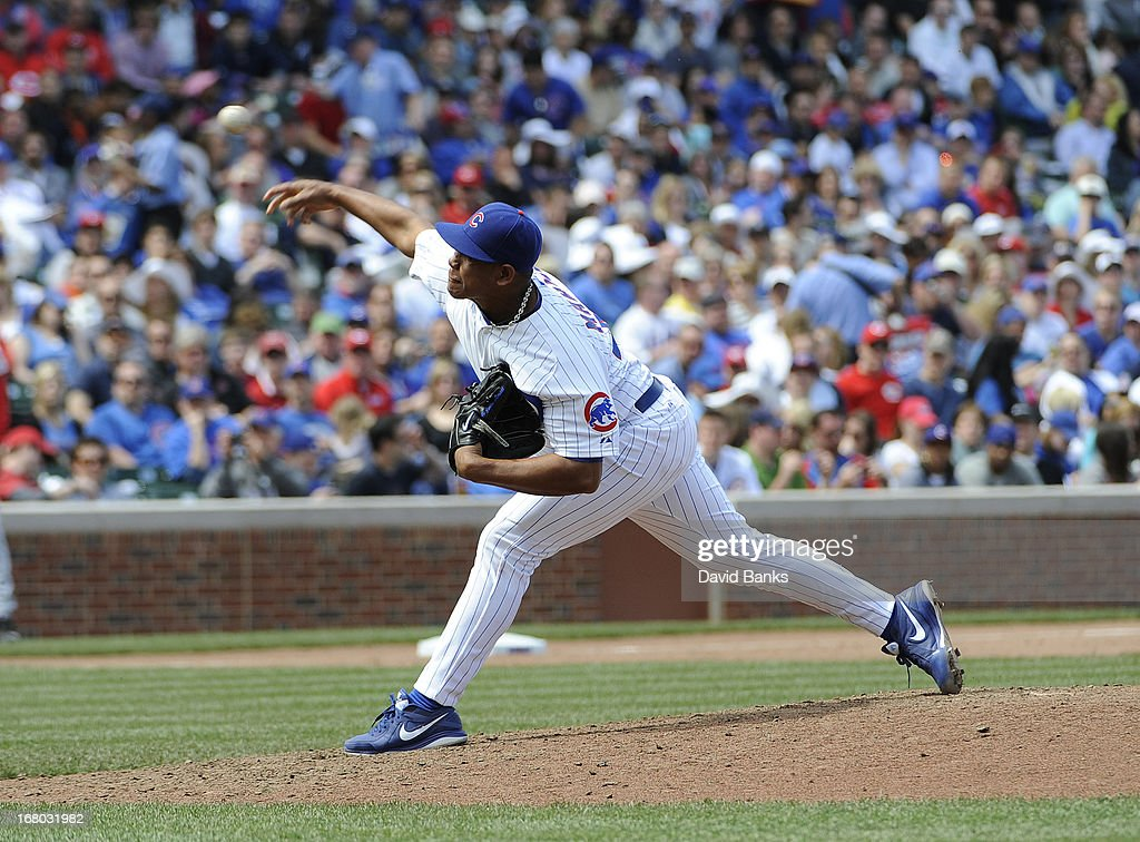 Carlos Marmol #49 of the Chicago Cubs pitches against the Cincinnati Reds during the eighth inning on May 4, 2013 at Wrigley Field in Chicago, Illinois.