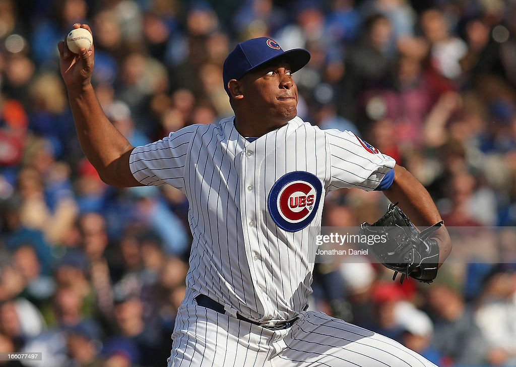 <a gi-track='captionPersonalityLinkClicked' href=/galleries/search?phrase=Carlos+Marmol&family=editorial&specificpeople=556707 ng-click='$event.stopPropagation()'>Carlos Marmol</a> #49 of the Chicago Cubs pitches in the 8th inning against the Milwaukee Brewers during the Opening Day game at Wrigley Field on April 8, 2013 in Chicago, Illinois. The Brewers defeated the Cubs 7-4.