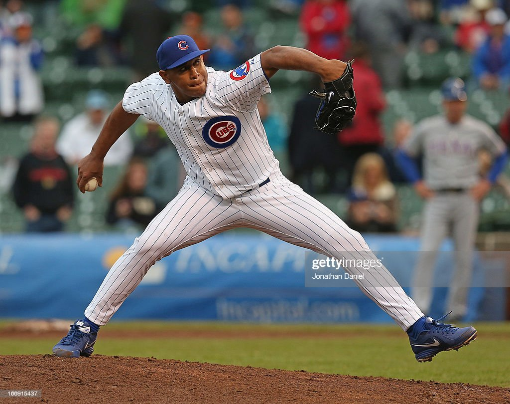 <a gi-track='captionPersonalityLinkClicked' href=/galleries/search?phrase=Carlos+Marmol&family=editorial&specificpeople=556707 ng-click='$event.stopPropagation()'>Carlos Marmol</a> #49 of the Chicago Cubs pitches in the 9th inning for a save against the Texas Rangers at Wrigley Field on April 18, 2013 in Chicago, Illinois. The Cubs defeated the Rangers 6-2.
