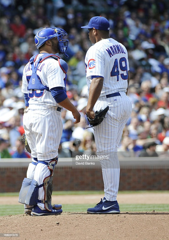 Carlos Marmol #49 of the Chicago Cubs talks with his catcher Welington Castillo #53 during the eighth inning on May 4, 2013 at Wrigley Field in Chicago, Illinois.