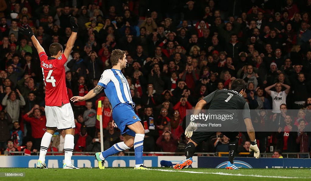 Carlos Martinez of Real Sociedad scores an own-goal during the UEFA Champions League Group A match between Manchester United and Real Sociedad at Old Trafford on October 23, 2013 in Manchester, England.