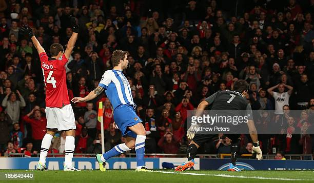 Carlos Martinez of Real Sociedad scores an owngoal during the UEFA Champions League Group A match between Manchester United and Real Sociedad at Old...
