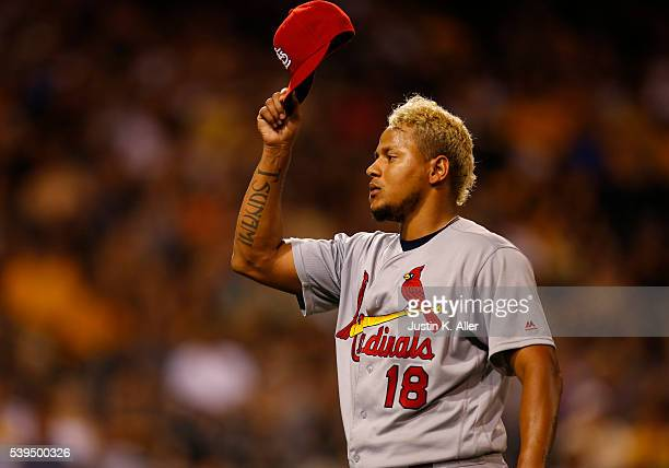 Carlos Martinez of the St Louis Cardinals acknowledges Cardinal fans after being removed in the ninth inning during the game against the Pittsburgh...