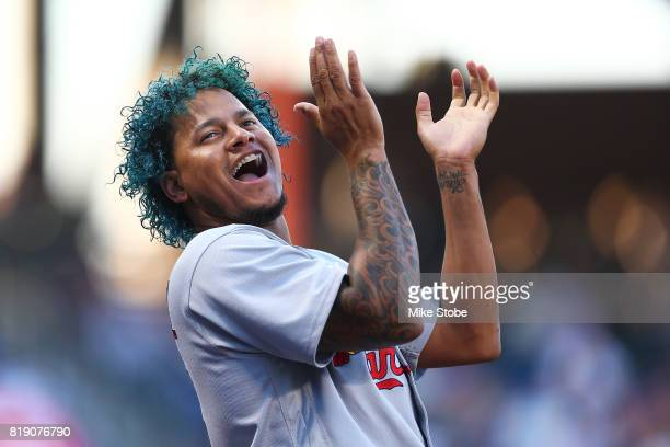 Carlos Martinez of the St Louis Cardinals cheers from the dugout in the first inning against the New York Mets at Citi Field on July 19 2017 in the...
