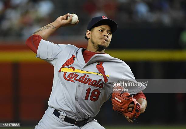 Carlos Martinez of the St Louis Cardinals delivers a first inning pitch against the Arizona Diamondbacks at Chase Field on August 27 2015 in Phoenix...