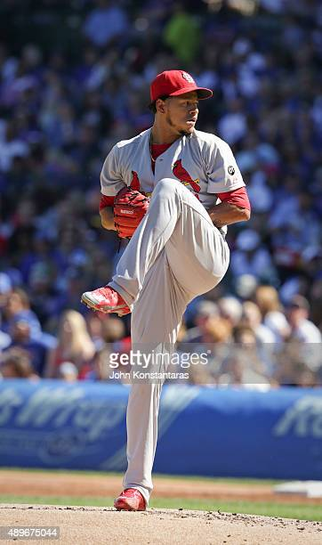 Carlos Martinez of the St Louis Cardinals delivers a pitch during the first inning against the Chicago Cubs at Wrigley Field on September 20 2015 in...