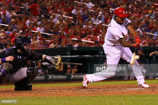 Carlos Martinez of the St Louis Cardinals drives in a run with a single against the Colorado Rockies in the fourth inning at Busch Stadium on July 26...