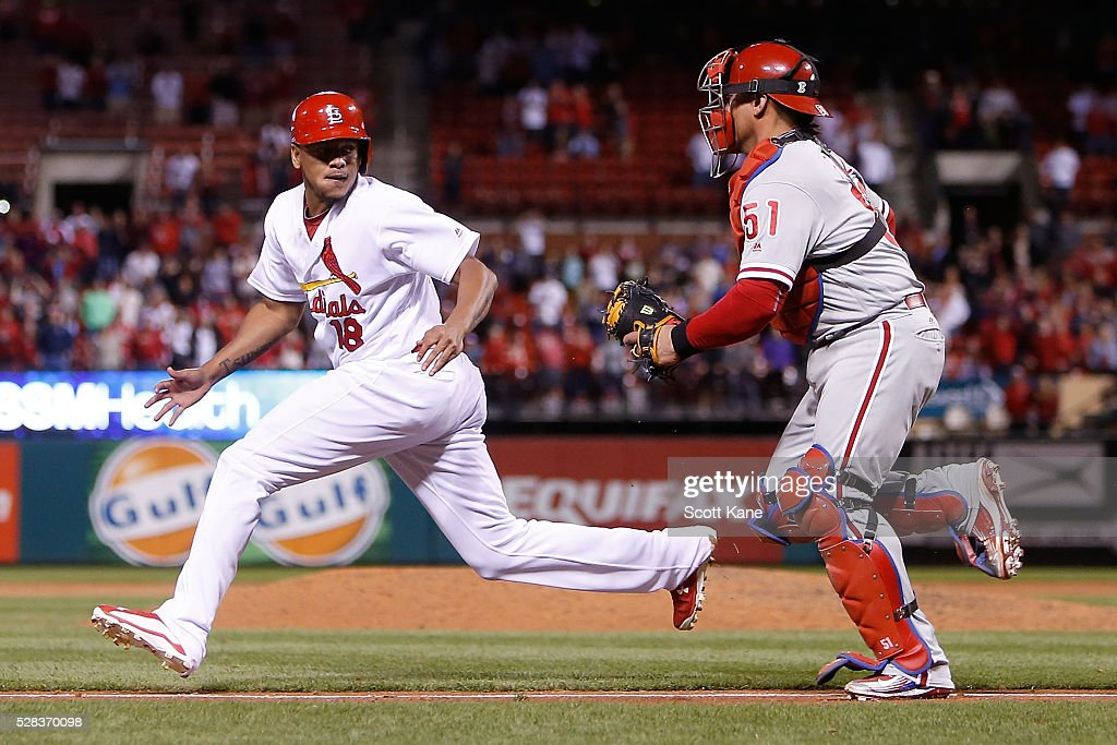 Carlos Martinez #18 of the St. Louis Cardinals gets caught in a rundown by Carlos Ruiz #51 of the Philadelphia Phillies during the ninth inning at Busch Stadium on May 4, 2016 in St. Louis, Missouri.