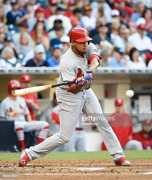 Carlos Martinez of the St Louis Cardinals hits a double during the third inning of a baseball game against the San Diego Padres at Petco Park August...