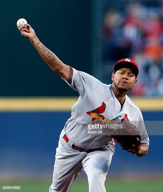 Carlos Martinez of the St Louis Cardinals pitches during the first inning of a baseball game against the Atlanta Braves at Turner Field on April 9...
