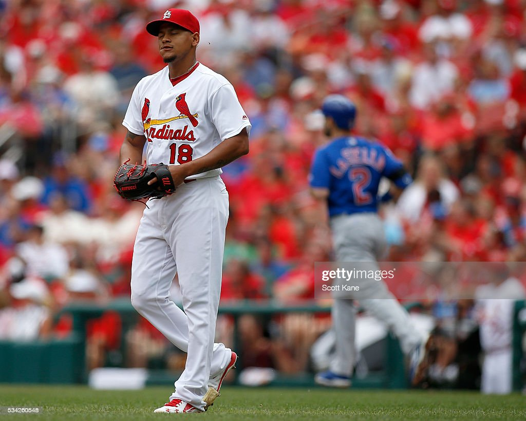 Carlos Martinez #18 of the St. Louis Cardinals reacts after walking Tommy La Stella #2 of the Chicago Cubs during the second inning at Busch Stadium on May 25, 2016 in St. Louis, Missouri.