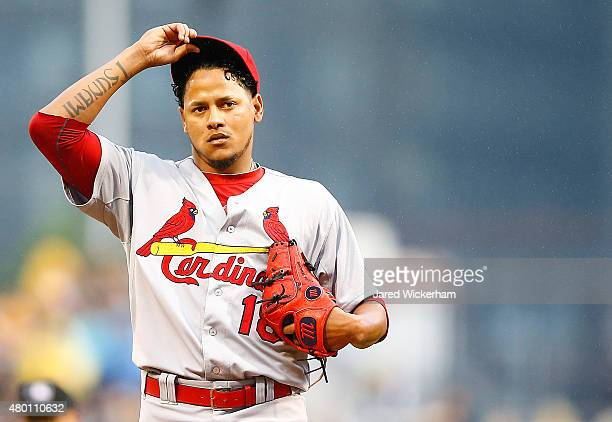 Carlos Martinez of the St Louis Cardinals takes a moment in between pitches in the third inning against the Pittsburgh Pirates during the game at PNC...