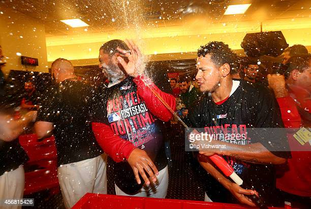 Carlos Martinez sprays Oscar Taveras of the St Louis Cardinals while celebrating in the locker room after defeating the Los Angeles Dodgers 32 in...