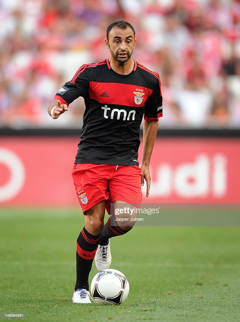 <a gi-track='captionPersonalityLinkClicked' href=/galleries/search?phrase=Carlos+Martins&family=editorial&specificpeople=685923 ng-click='$event.stopPropagation()'>Carlos Martins</a> of Benfica runs with the ball during the Eusebio Cup match between Benfica and Real Madrid at Estadio da Luz on July 27, 2012 in Lisbon, Portugal.
