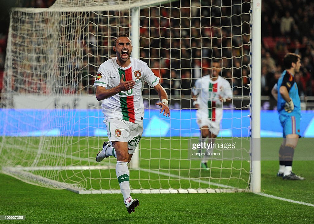 <a gi-track='captionPersonalityLinkClicked' href=/galleries/search?phrase=Carlos+Martins&family=editorial&specificpeople=685923 ng-click='$event.stopPropagation()'>Carlos Martins</a> of Portugal celebrates scoring his sides opening goal as goalkeeper <a gi-track='captionPersonalityLinkClicked' href=/galleries/search?phrase=Iker+Casillas&family=editorial&specificpeople=215446 ng-click='$event.stopPropagation()'>Iker Casillas</a> (R) of Spain stands dejected during the International Friendly match between Portugal and Spain at the Estadio da Luz on November 17, 2010 in Lisbon, Portugal.