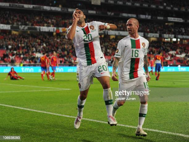 Carlos Martins of Portugal celebrates scoring his sides opening goal with his teammate Raul Meireles during the International Friendly match between...