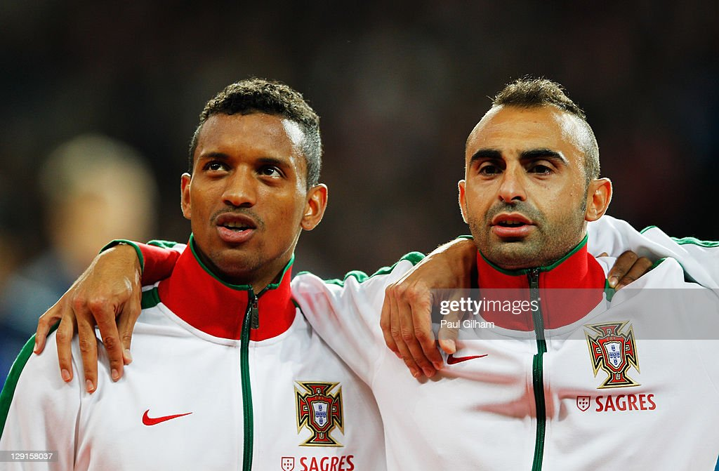 <a gi-track='captionPersonalityLinkClicked' href=/galleries/search?phrase=Carlos+Martins&family=editorial&specificpeople=685923 ng-click='$event.stopPropagation()'>Carlos Martins</a> of Portugal looks on alongside Nani of Portugal during the national anthem prior to the start of during the EURO 2012 group H qualifier match between Denmark and Portugal at Parken Stadium on October 11, 2011 in Copenhagen, Denmark.
