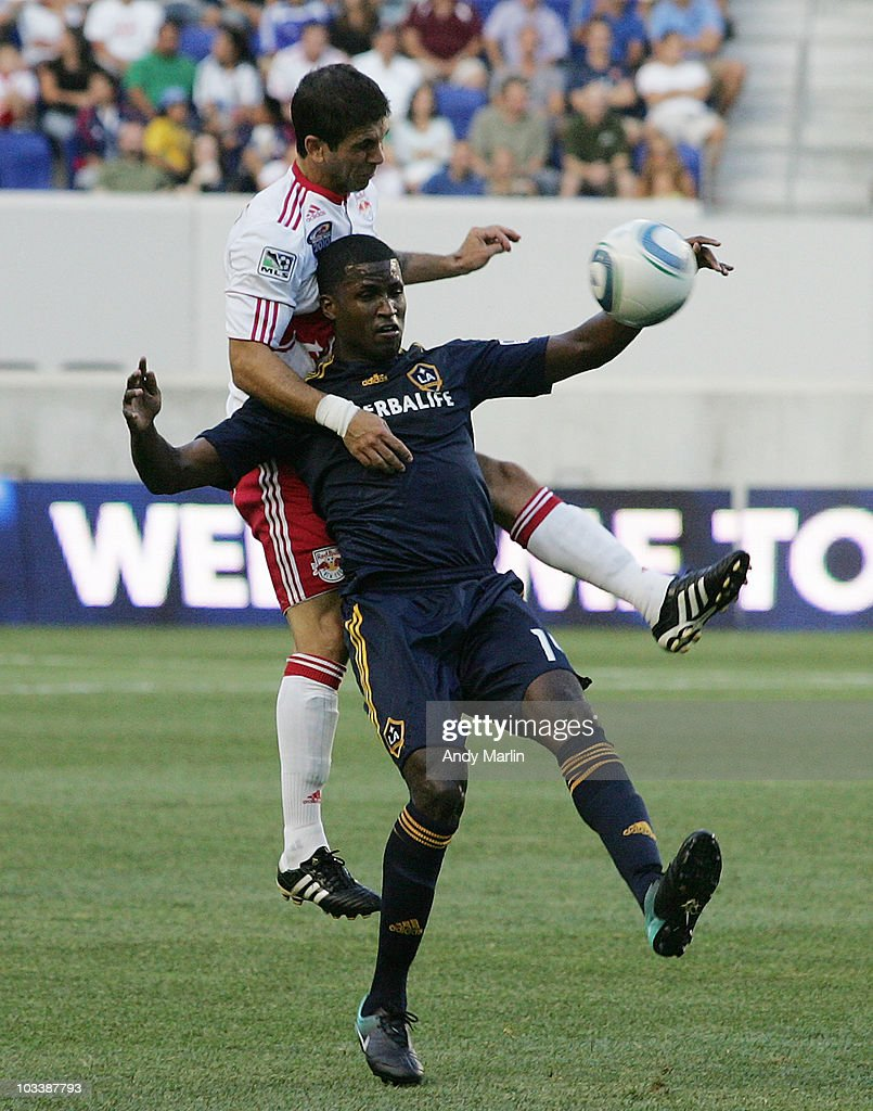 Carlos Mendes #44 of the New York Red Bulls climbs the back of Edson Buddle #14 of the Los Angeles Galaxy during the game at Red Bull Arena on August 14, 2010 in Harrison, New Jersey. The Galaxy defeated the Red Bulls 1-0.
