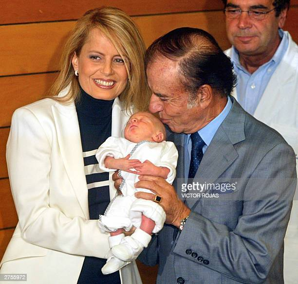 Carlos Menem a controversial figure as Argentina's president from 19891999 and his Chileanborn wife former beauty queen Cecilia Bolocco hold their...