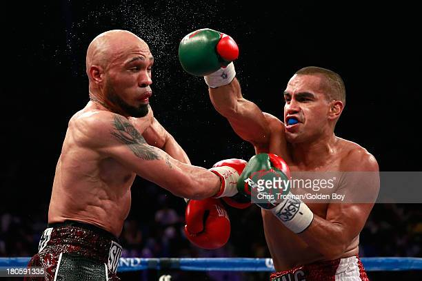 Carlos Molina throws a right to the head of Ishe Smith during their IBF junior middleweight title fight at the MGM Grand Garden Arena on September 14...