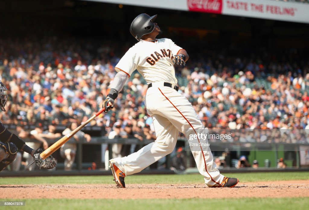 Carlos Moncrief #39 of the San Francisco Giants hits a sacrifice fly that scored Brandon Crawford #35 in the eighth inning against the Milwaukee Brewers at AT&T Park on August 23, 2017 in San Francisco, California.