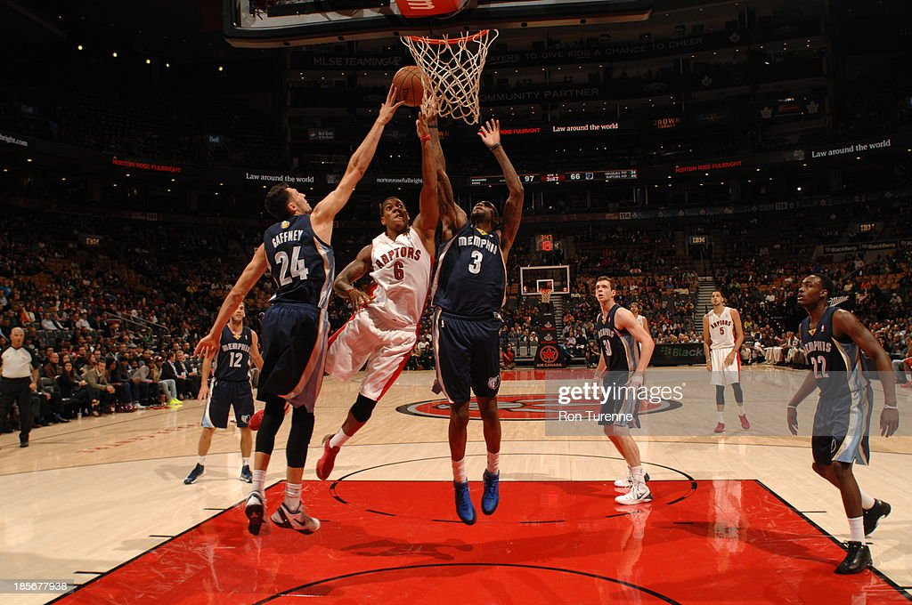 <a gi-track='captionPersonalityLinkClicked' href=/galleries/search?phrase=Carlos+Morais&family=editorial&specificpeople=1101771 ng-click='$event.stopPropagation()'>Carlos Morais</a> #6 of the Toronto Raptors drives to the basket against <a gi-track='captionPersonalityLinkClicked' href=/galleries/search?phrase=Tony+Gaffney&family=editorial&specificpeople=5610881 ng-click='$event.stopPropagation()'>Tony Gaffney</a> #24 and Willie Reed #3 of the Memphis Grizzlies during the game on October 23, 2013 at the Air Canada Centre in Toronto, Ontario, Canada.