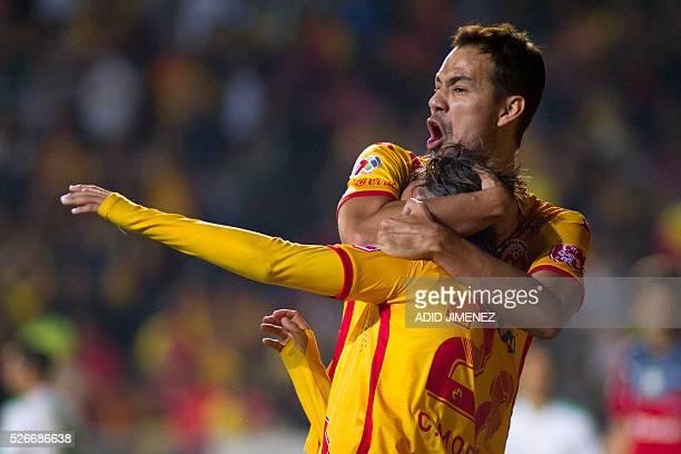 Carlos Morales of Morelia celebrates his goal against Santos with teammate Pablo Velazquez during their Mexican Clausura 2016 tournament football...