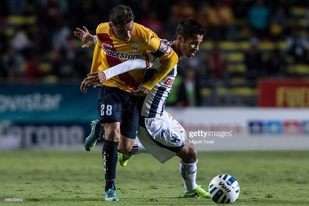 Carlos Morales of Morelia holds Severo Meza of Monterrey as they try to get the ball during a match between Morelia and Monterrey as part of 15th...