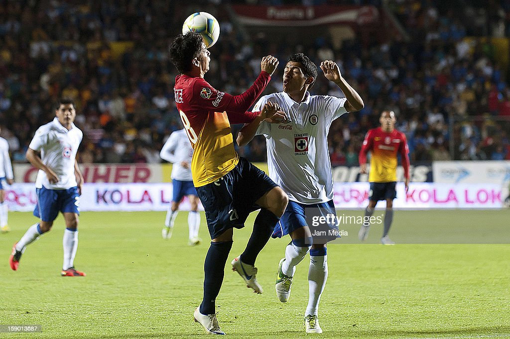 Carlos Morales (L) of Morelia struggles for the ball with <a gi-track='captionPersonalityLinkClicked' href=/galleries/search?phrase=Javier+Aquino&family=editorial&specificpeople=7218711 ng-click='$event.stopPropagation()'>Javier Aquino</a> (R) of Cruz Azul during a match as part of the Clausura 2013 Liga MX at Morelos Stadium on january 04, 2013 in Morelia, Mexico.