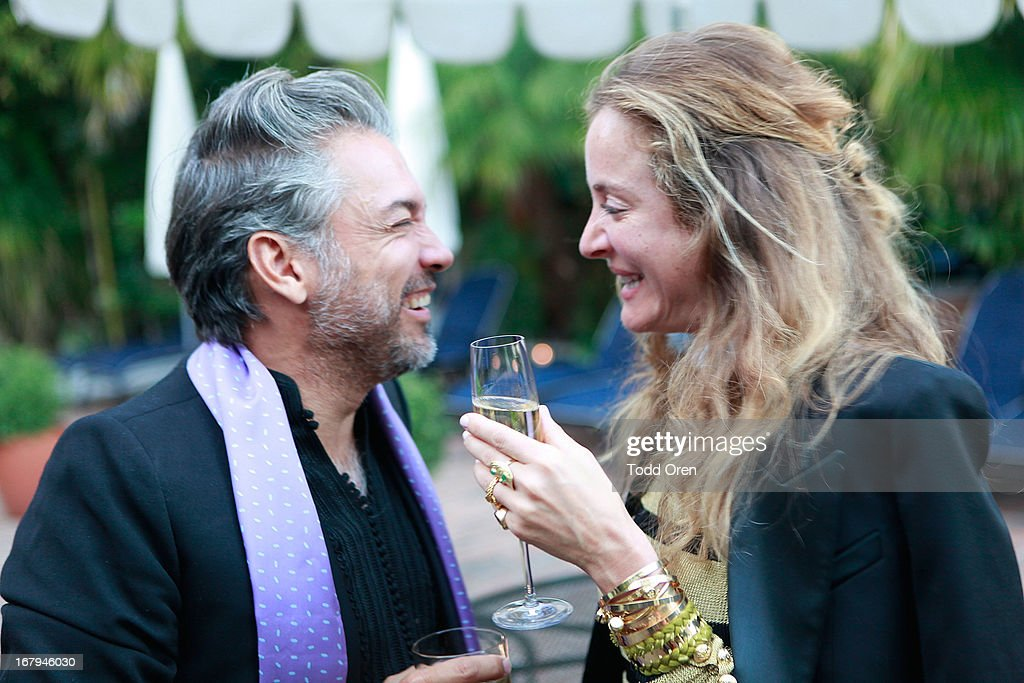 Carlos Mota and Aurelie Bidermann talk at the Balmain LA Dinner at Chateau Marmont on May 2, 2013 in Los Angeles, California.