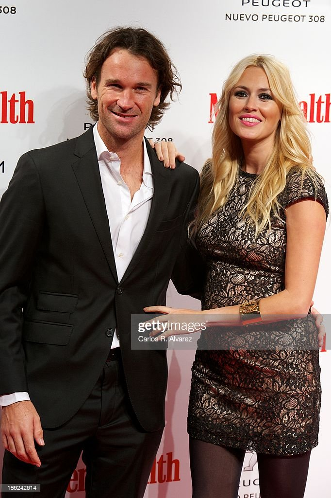 Carlos Moya and Carolina Cerezuela attend Men's Health Awards 2013 at the Canal Theater on October 29, 2013 in Madrid, Spain.