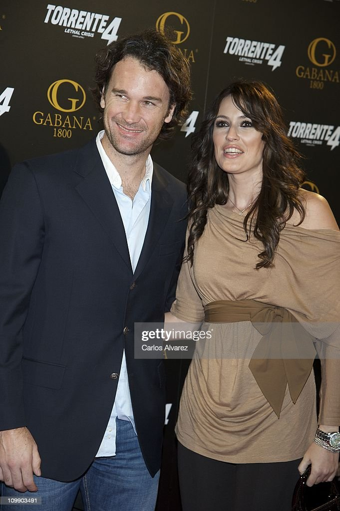 <a gi-track='captionPersonalityLinkClicked' href=/galleries/search?phrase=Carlos+Moya&family=editorial&specificpeople=171236 ng-click='$event.stopPropagation()'>Carlos Moya</a> and his wife Carolina Cerezuela attend 'Torrente 4' premiere at the Capitol cinema on March 9, 2011 in Madrid, Spain.