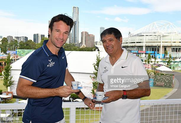 Carlos Moya of Spain poses with Toni Nadal at the Lavazza Cafe during day two of the 2017 Australian Open at Melbourne Park on January 17 2017 in...