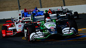 Carlos Munoz of Colombia driver of the Andretti Autosport Honda Dallara leads a pack of cars during the Verizon IndyCar Series GoPro Grand Prix of...