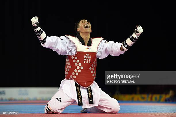 Carlos Navarro of Mexico celebrates his victory and a gold medal against Luisito Pie of Dominican Republic in the Taekwondo Men's 58kg Final at the...