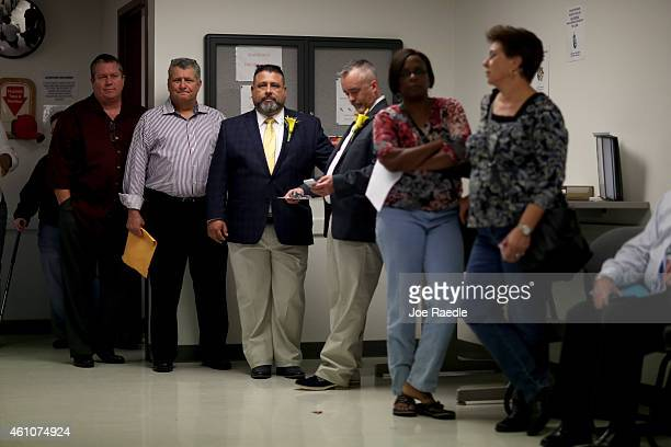 Carlos Noda and his husband to be Rich Matthews stand in line with others waiting to get their marriage license from the Clerk of the Court at the...