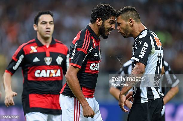 Carlos of Atletico MG and Wallace of Flamengo battle for the ball during a match between Atletico MG and Flamengo as part of Copa do Brasil 2014 at...