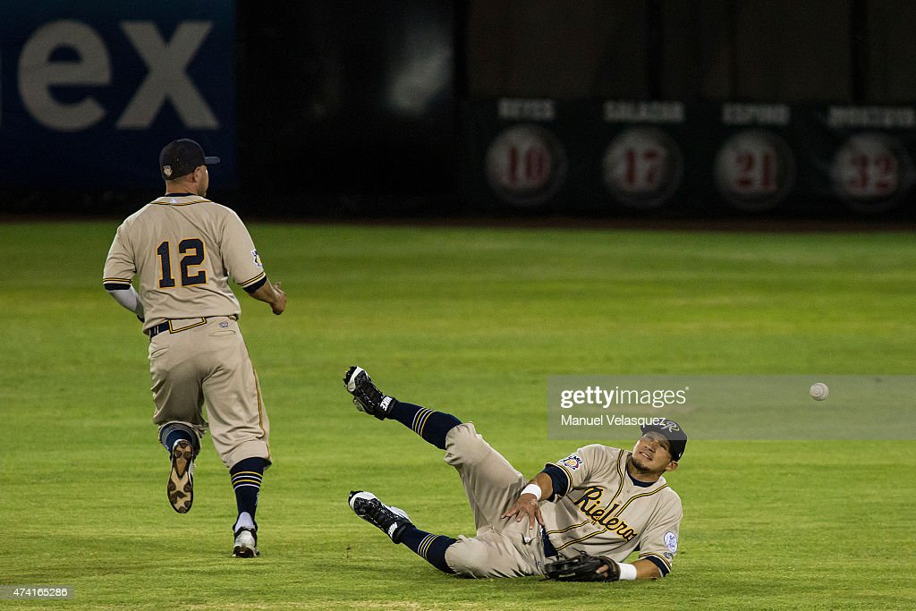Carlos Orrantia (L) and Eliezer Ortiz (R) of Rieleros de Aguascalientes fail in catching the ball during a match between Rieleros de Aguascalientes and Diablos Rojos as part of Mexican Baseball League 2015 at Fray Nano Stadium on May 20, 2015 in Mexico City, Mexico.