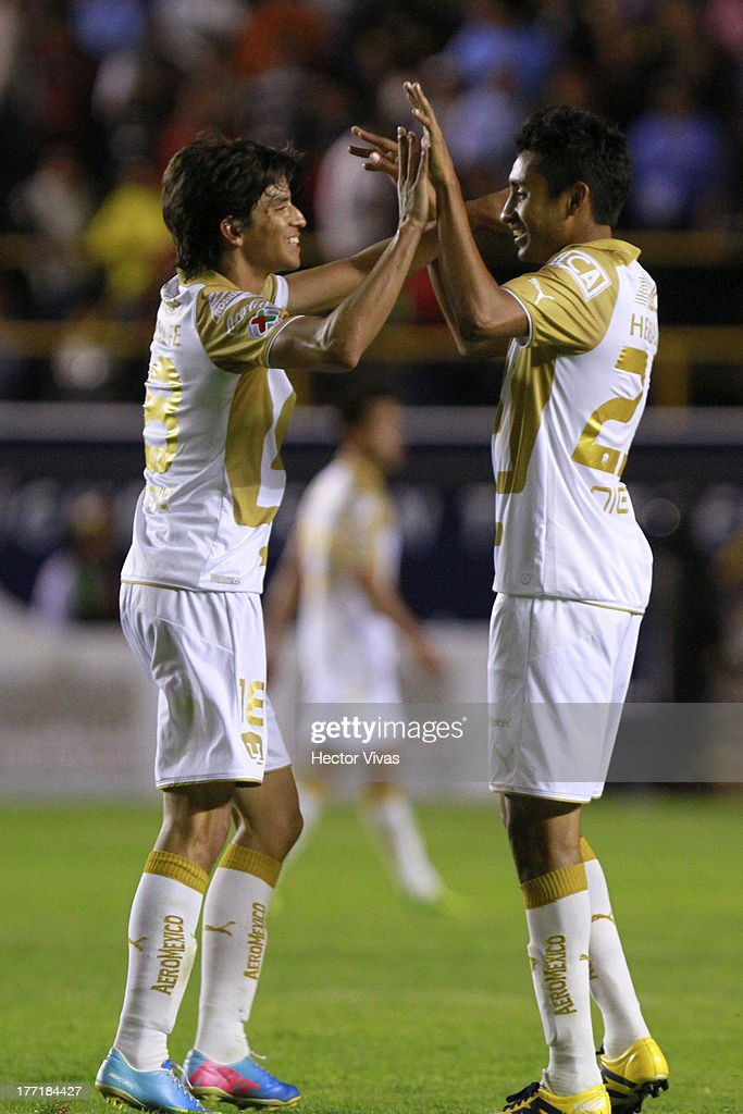 Carlos Orrantia and Jose Nieto of Pumas celebrate during a match between San Luis and Pumas as part of the Apertura 2013 Copa MX at Alfonso Lastras...