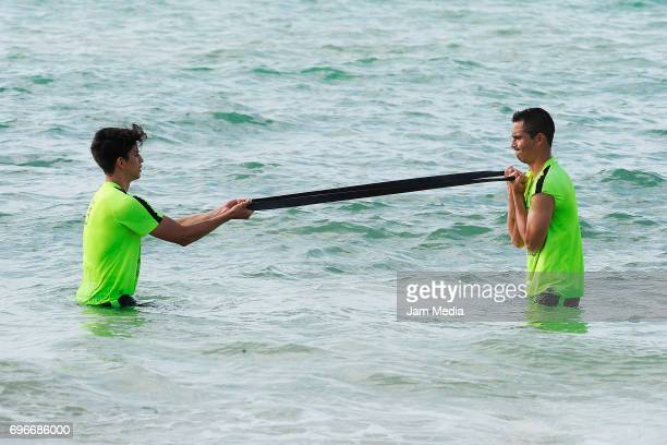 Carlos Orrantia and Paul Aguilar of America train in the water during the Pre Season training for the Torneo Apertura 2017 of la Liga Bancomer MX at...